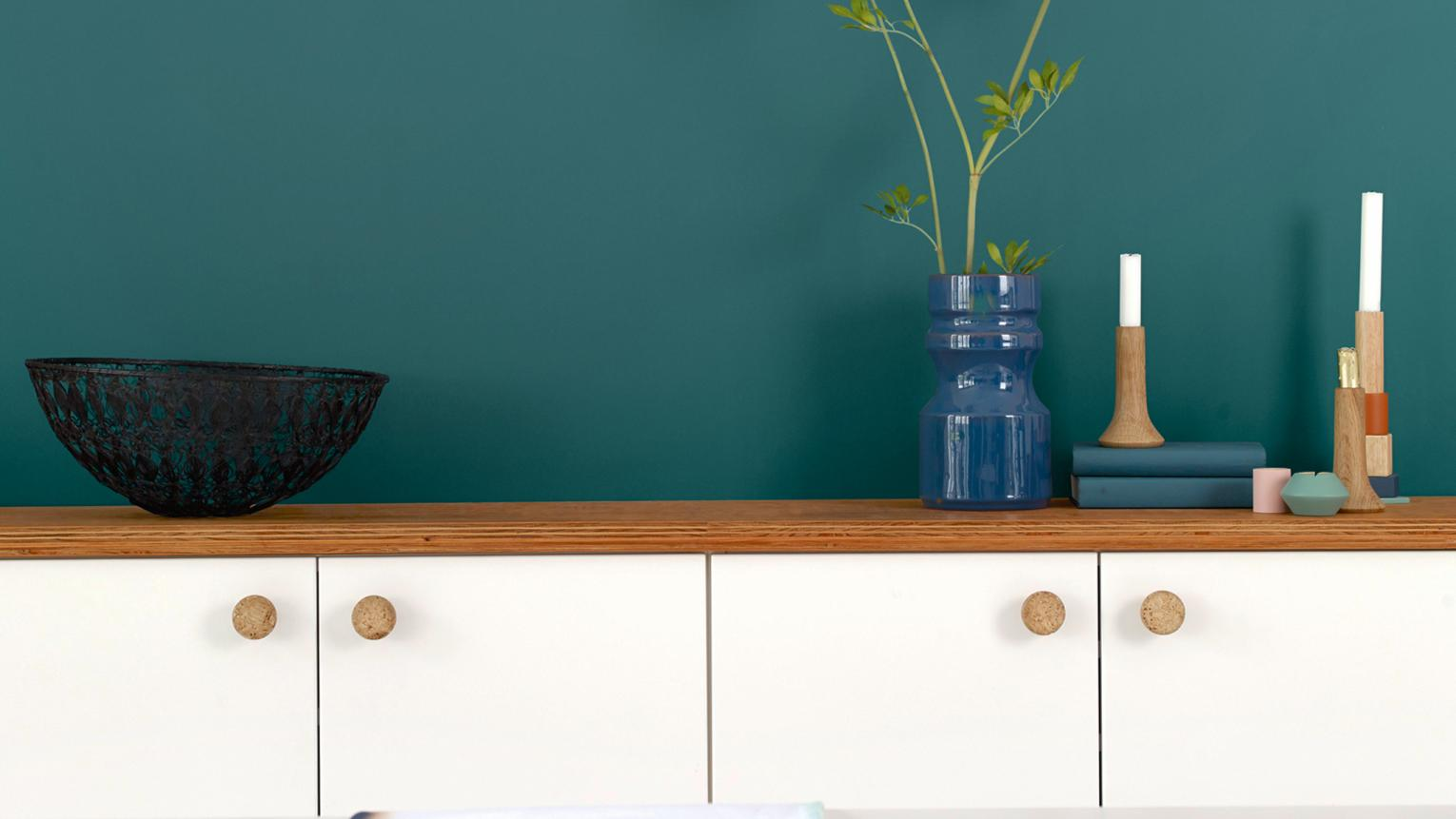 White kitchen? For an easy update, why not create a dramatic feature wall with majestic teal colour.