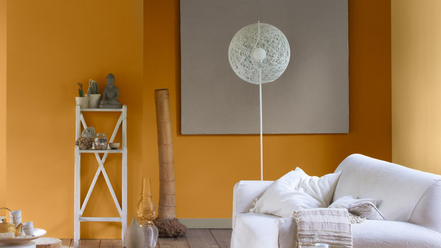 If it's warmth you're after, don't be afraid to use light terracotta or orange paint colours – a sunny hue can brighten and warm a dark, dingy space.