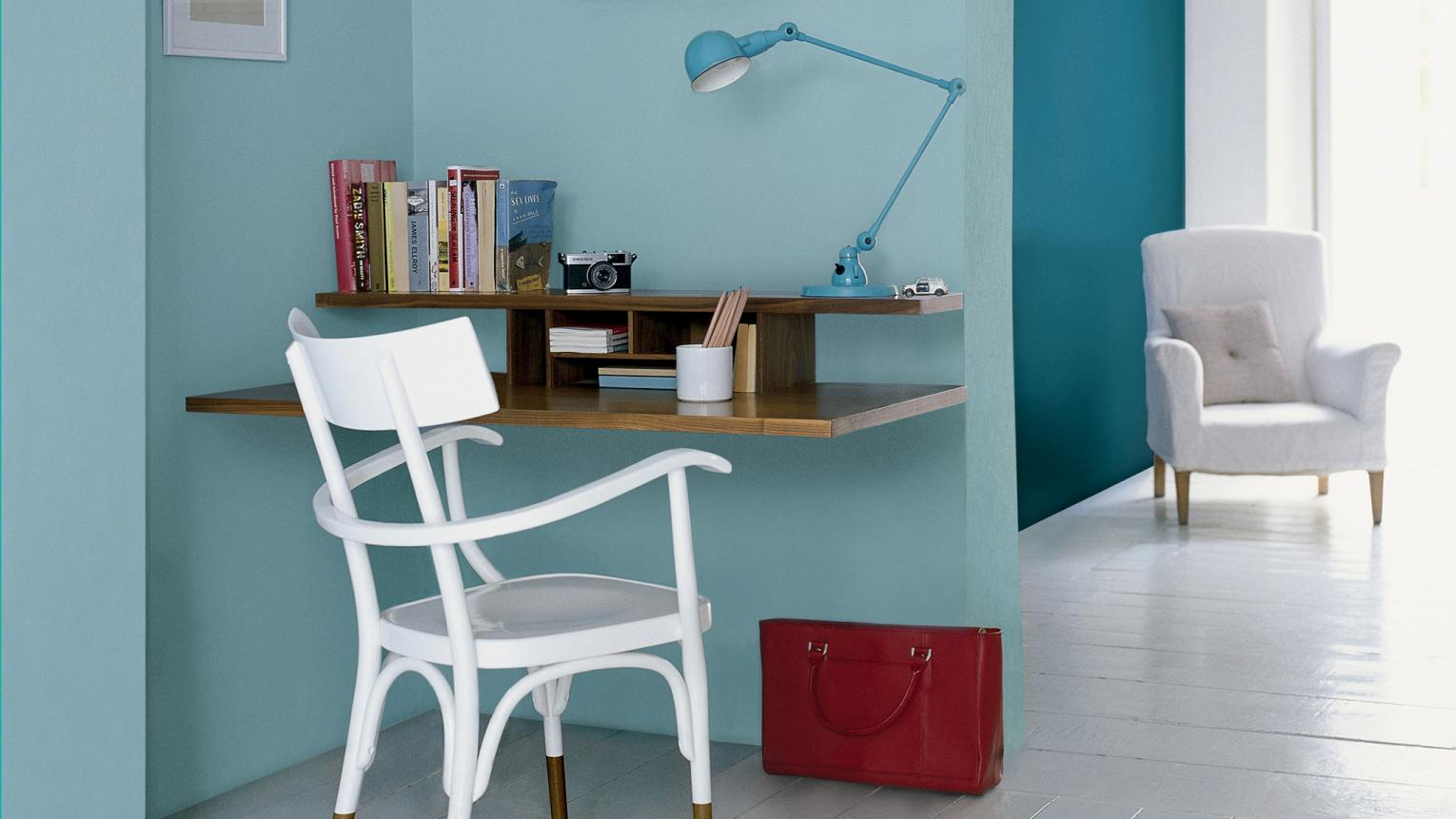 Contrast hazy blue with bold teal for inspiring office impact.