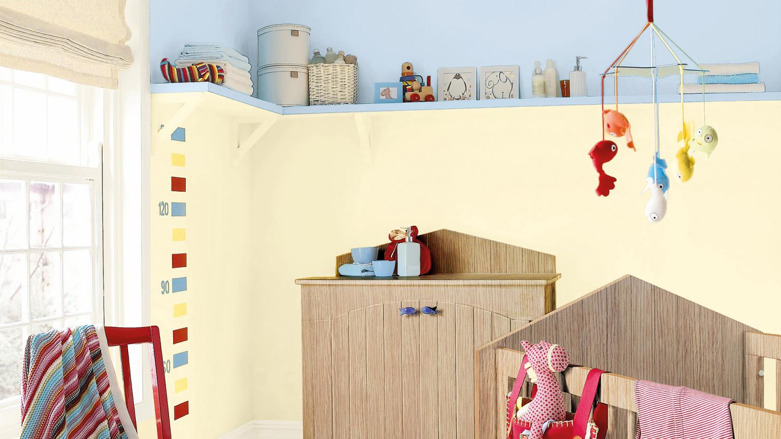 Choose gentle shades of yellow and blue for a pretty baby's room.