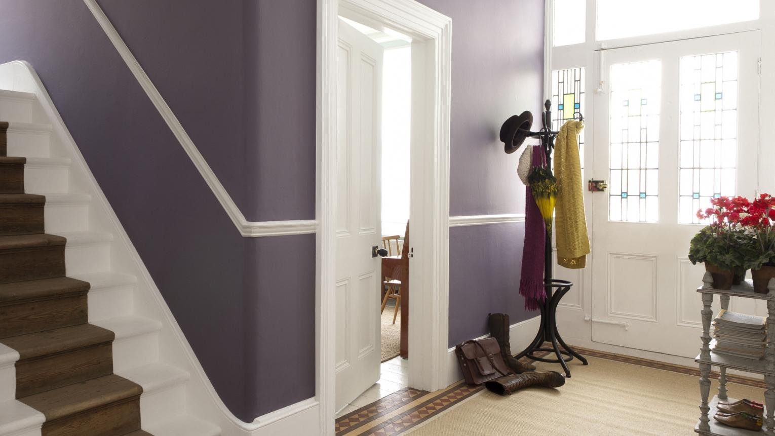Use a deep shade of purple to enhance a grand entrance hall.