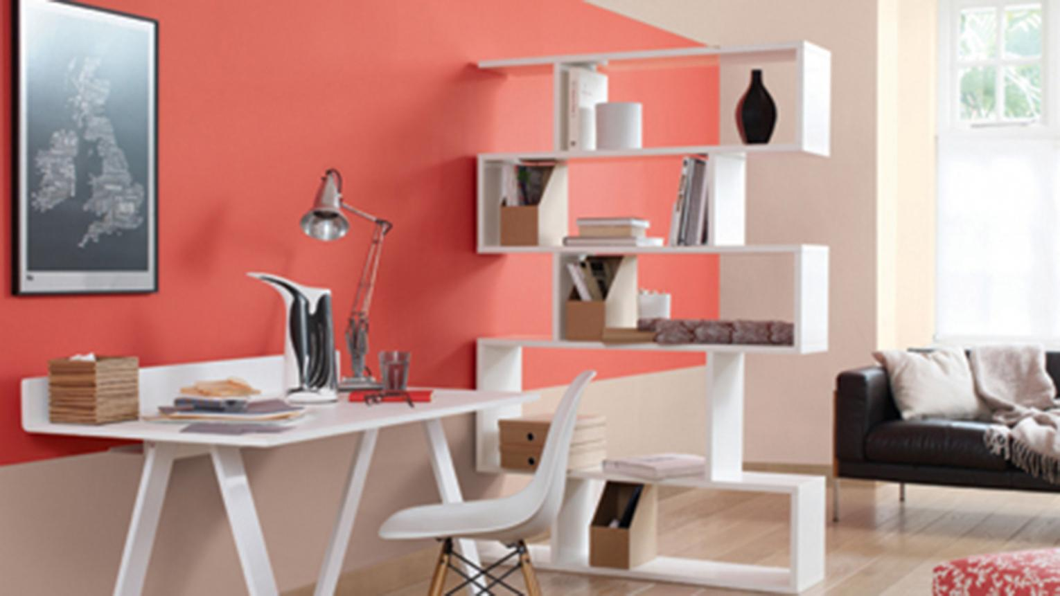 Pure-white shelving adds contrast to warm coral.