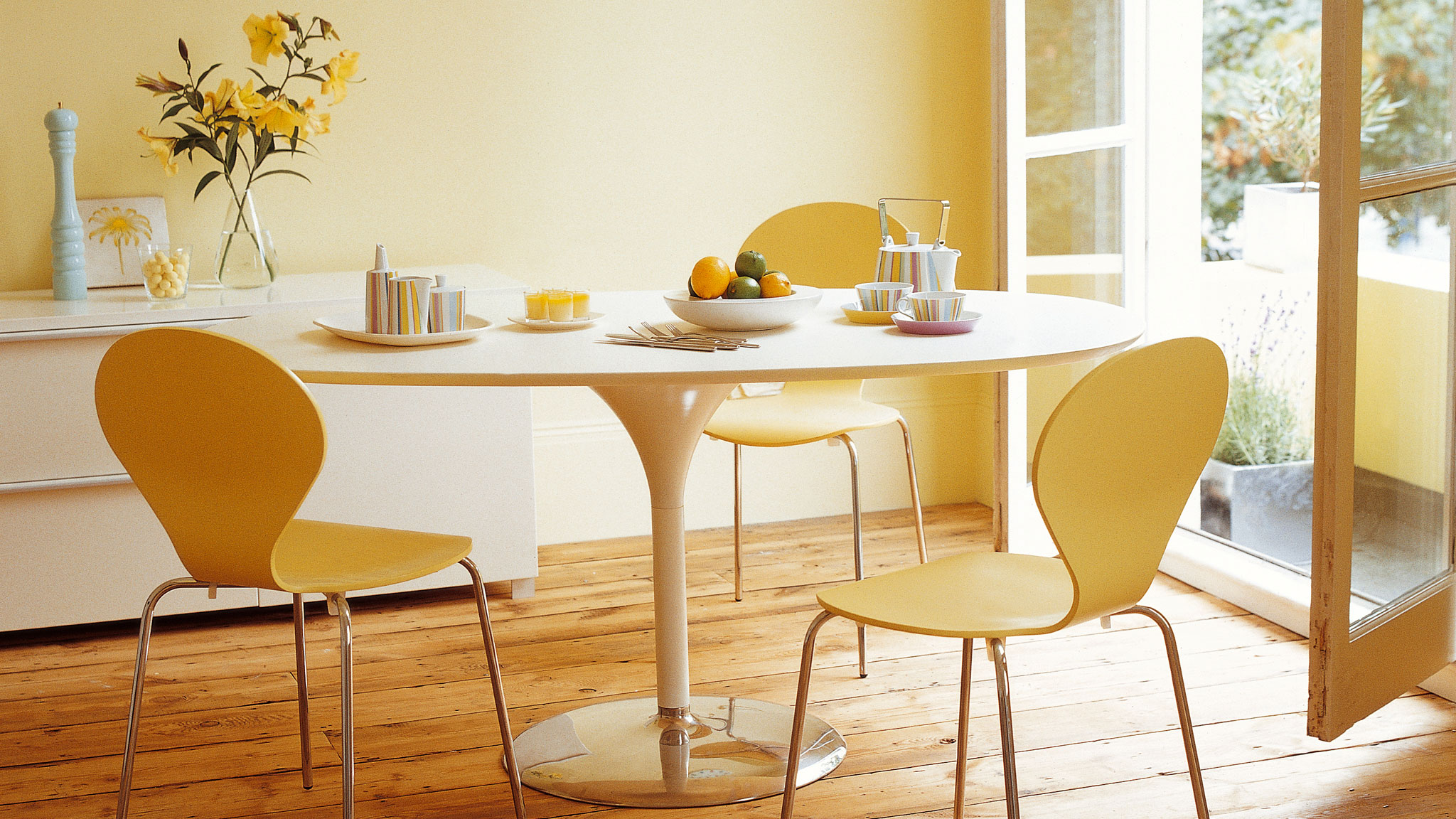 A sunny hue can brighten and warm a dark, dingy space: don't be afraid to use light terracotta or yellow paint colours